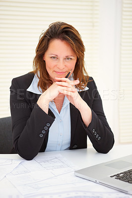 Buy stock photo Portrait of a happy mature business woman sitting on her desk