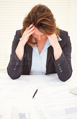 Buy stock photo Tensed mature business woman at work