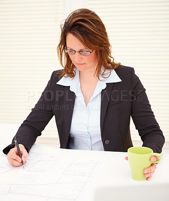 Buy stock photo Successful business woman working on the blue prints