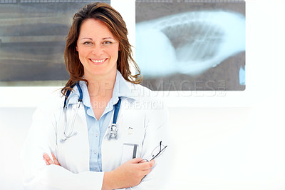 Buy stock photo Portrait of a confident mature female doctor smiling