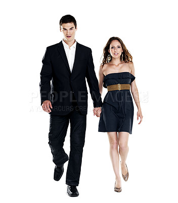 Buy stock photo Portrait of a beautiful young couple walking on white background