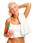 Attractive young woman with bottle in hand and towel around neck