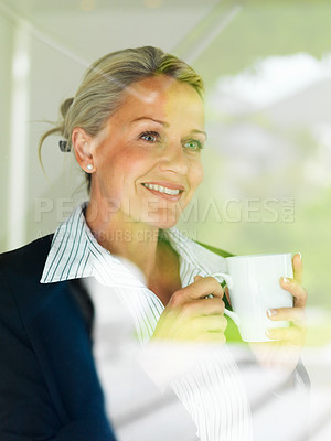 Buy stock photo Portrait of a middle aged business woman drinking coffee while looking outside through window