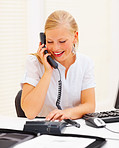 Secretary using a telephone in office