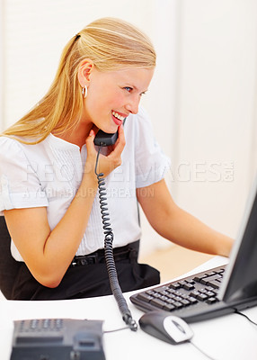 Buy stock photo Secretary sitting in office with computer, using a telephone
