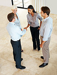 Successful business team at office shaking hands