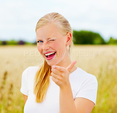 Buy stock photo Happy beautiful young woman snapping fingers at a field