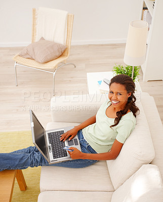 Buy stock photo Top view of an African American woman on sofa using laptop