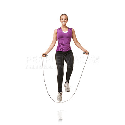 Buy stock photo Portrait of an attractive young woman skipping in the studio