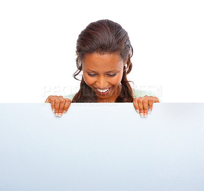 Buy stock photo Happy young African American female holding a blank billboard over white