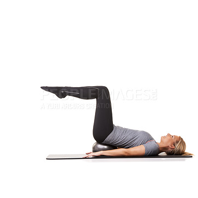 Buy stock photo A young woman performing leg exercises while isolated on a white background