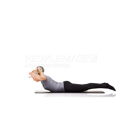 Buy stock photo A young woman working out with an exercise ball while isolated on a white background