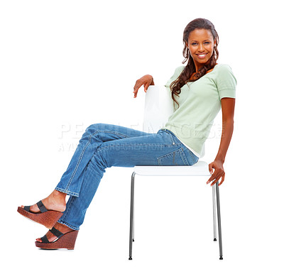 Buy stock photo Cute African American female sitting on a chair isolated on a white background