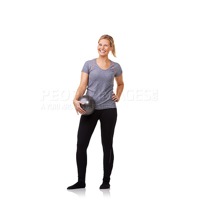 Buy stock photo A pretty young blonde holding an exercise ball after an invigorating workout