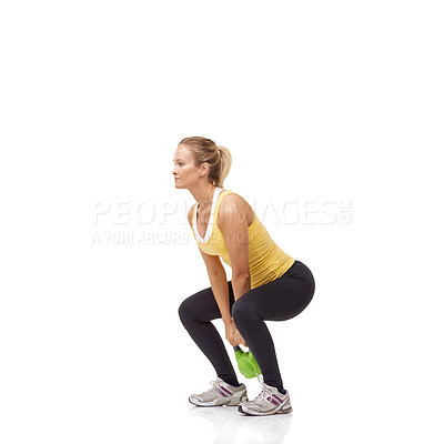 Buy stock photo A beautiful blonde woman performing a two-handed kettlebell swing