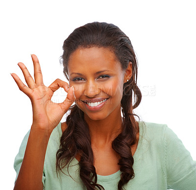 Buy stock photo Portrait of a cute young female showing an OK sign isolated over white