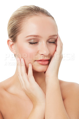 Buy stock photo A pretty young woman relishing the feel of her smooth skin