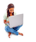 Happy young female working on a laptop over white
