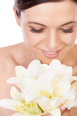 Buy stock photo A beautiful woman smelling a bouquet of white lilies