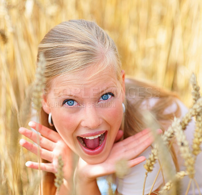 Buy stock photo Young excited happy female sitting between a crop field