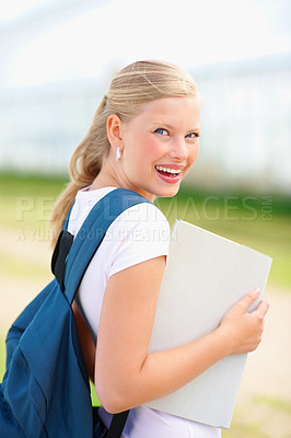 Buy stock photo Portrait of a happy female student with a folder outdoor