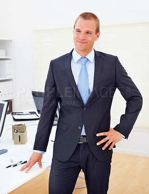 Buy stock photo Portrait of confident handsome business man posing in the office