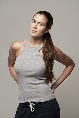 Buy stock photo Studio portrait of a fit young woman in exercise clothing