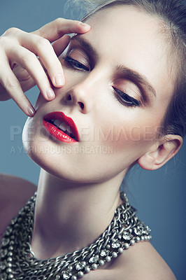 Buy stock photo Closeup shot of a gorgeous young woman wearing bright red lipstick and an elegant necklace