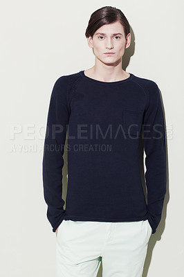Buy stock photo A handsome young man with elegant facial features posing for a studio shoot
