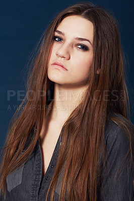 Buy stock photo A gorgeous model eyeing you intensely during a photo shoot in studio