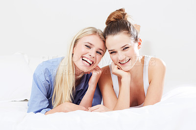 Buy stock photo Portrait of two good friends relaxing in bed together
