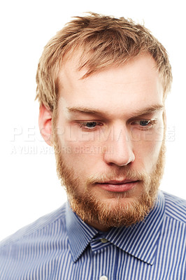 Buy stock photo An unshaven young man looking down isolated on white