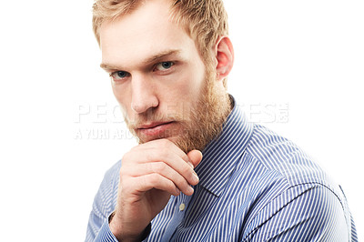Buy stock photo Portrait of a young man with his hand on his chin isolated on white