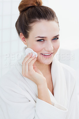 Buy stock photo A gorgeous teenage girl cleaning her skin