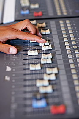 Buy stock photo Cropped close-up image of a hand moving a slider on a mixing desk