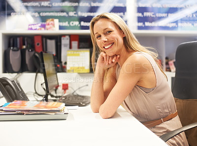 Buy stock photo Cropped portrait of a smiling businesswoman sitting at her desk
