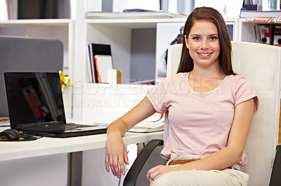 Buy stock photo Cropped portrait of a young businesswoman sitting at her desk