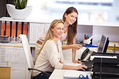 Buy stock photo Cropped portrait of two female coworkers working in the office