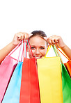 Happy young woman with colorful shopping bags on white