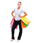 Attractive young woman standing isolated with her shopping bags