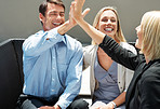 Successful deal - Man giving a high five to a financial planner