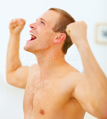 Buy stock photo Achievement - Excited young guy with clenched fist shouting