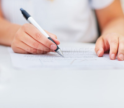 Buy stock photo Closeup of a business woman signing an agreement, focus on her hands