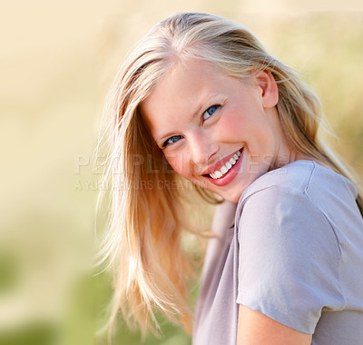 Buy stock photo Gorgeous young blond female smiling while outdoors