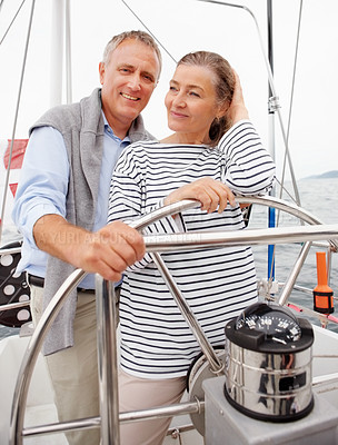 Buy stock photo Happy retired steering a boat on their voyage