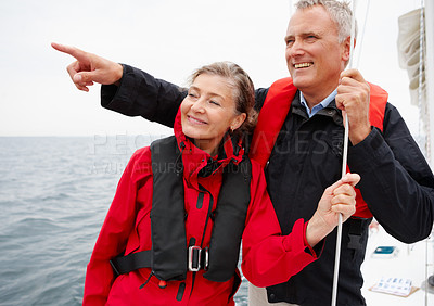 Buy stock photo Happy retired couple enjoying a sea voyage vacation