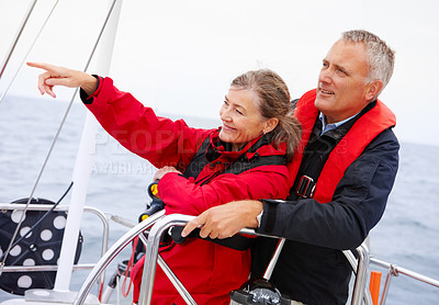 Buy stock photo Happy elderly couple enjoying a sea voyage vacation