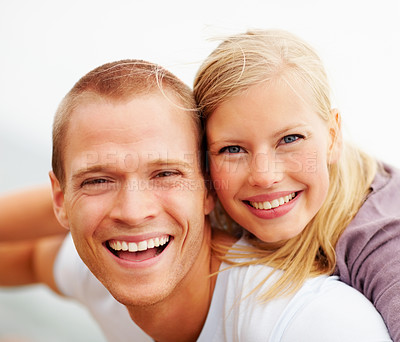 Buy stock photo Closeup portrait of a cute young couple smiling outdoors