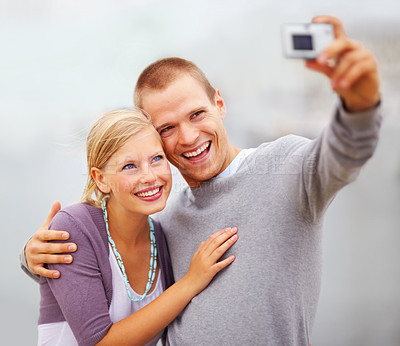 Buy stock photo Self portrait photography - Happy young couple smiling outdoors