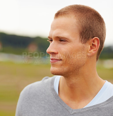 Buy stock photo Thoughtful happy young casual man outdoor